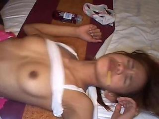 Pretty Thai girl Tia 18 gets semen load during TV