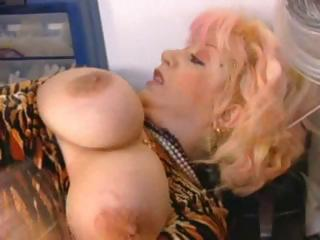 Busty Mature Blonde Gets A Young Buck To...