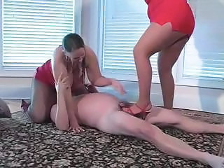 Belle and Lori sit on his face and step on his dick with high heels