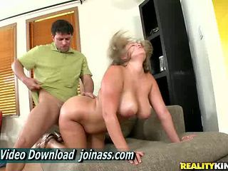 Ellie May A Huge Cock In Between Her Tits And Legs