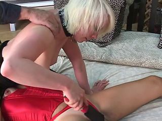 Flunkey worships mistresses pussy and mistress spanks slaves pussy with a paddle