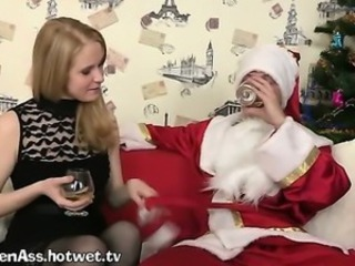 Santa Gets A Warm Blowjob On The Couch