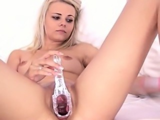 Blonde slut inserting gyno toys inside