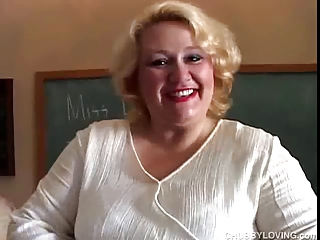 Chubby MILF teacher gets out her lovely big tits while she