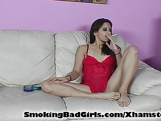 Teen smoking menthol while flashing pussy
