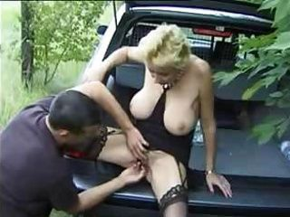 Busty granny gets fingered in the backseat of a car and then fucked nicely