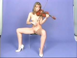 Mysterious receiver general with a nervous nest poses in her underwear, naked playing the violin and in her lingerie