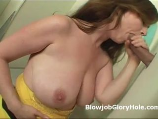 Violet sucks cock through glory hole