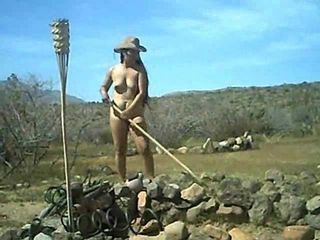 Nude female farm employee outdoor