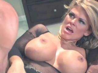 Busty blonde in fishnets titty fucks and then gets banged hard