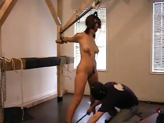 Tied up slave gets the water and wax torture treatment by master