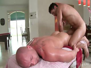 Sexy gay masseur getting a hot blowjob from his client