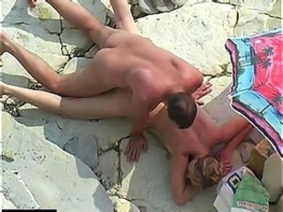 Hot joystick fucking under sands voyeur care