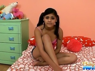 Sexy latina babysitter Gina is caught sleeping on the bed