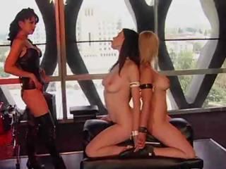 Two hot babes get tied up and tortured in this BDSM video