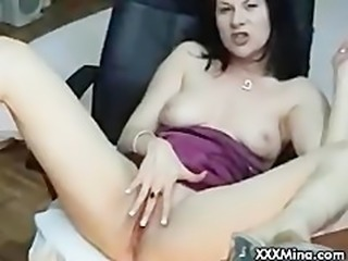 Brunette babe smoking and masturbating on cam