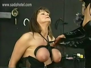 Masked Dominatrix in latex ties the big tits of slave with together with a...
