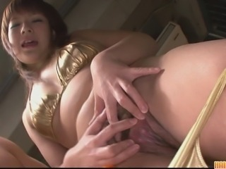 Cute and sweltering brunette pet in her acquisitive and sexy gold bikini. She strips...