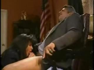 Yummy brunette nympho gives the president a blowjob under his desk