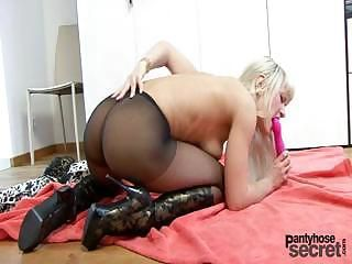 Blonde Anita likes to masturbate through her nylons