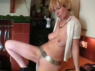 British blonde mature does a striptease and toys her pussy