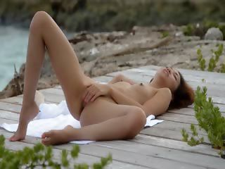 korean angel teasing by the ocean