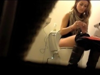 Absolutely gorgeous girl using the bathroom