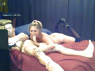 Blonde Slut With Black Stockings Gives Man A Long Blowjob