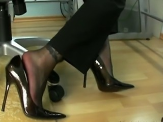 woman in block stockings is giving a footjob in black stockings and gets a...