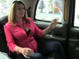 British babe flashing huge tits in fake taxi
