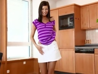 Kitchen Seductions close to the Graceful black haired Siren Megan