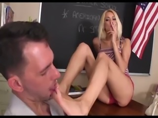 Teacher becomes the foot slave