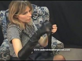Gorgeous Milf puts on sexy leather gloves and turns into fetish mis...