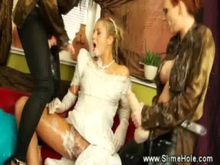 She gets drenched and filled by the strapon lesbians