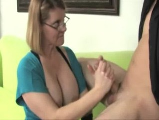 Busty mature with glasses waxes her boytoys dolphin