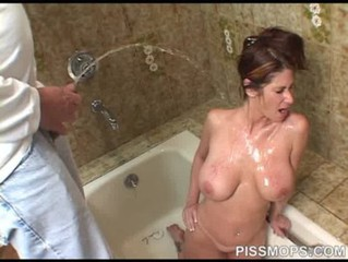 Tiffany Mynx drinks hot piss at PissMops - http://allthingsfetish.com/