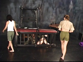 Three lesbians in torture chamber strip and one bends over for spanking