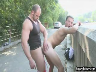 Two uncut guys fuck next to the highway