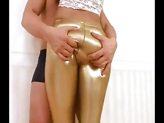 Girl in sexy latex leggings getting naughty with her boy