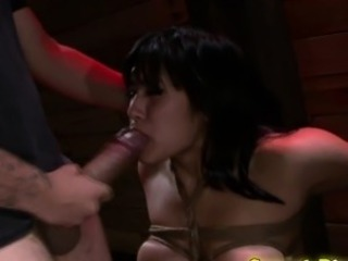 Asian bondage slave sucks