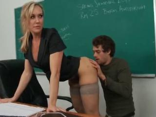 Bosomy hot blond MILF teacher shows tight body