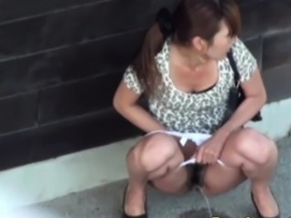 Leggy asian babe urinates outdoors