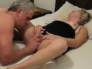Mature Couple Having Game Surrounding Bed With A Dildo