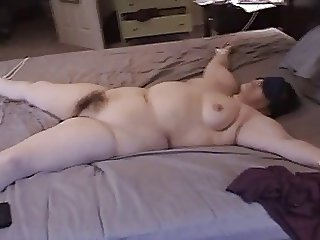 Tied-up BBW wife gagging while swallowing huge cum load