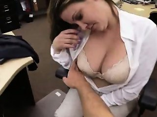 Busty brunette babe showing her tits at the pawn shop