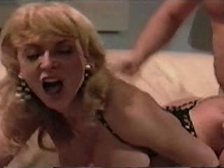 "Nina Hartley in a hot anal scene"" class=""th-mov"