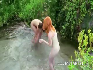 Two beautiful babes strip in outdoors