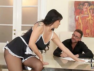 Maid gives his boss a hot footjob