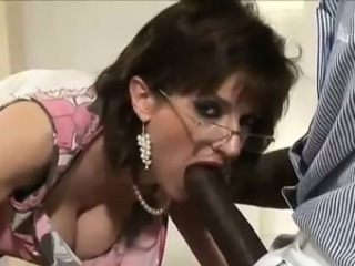 Slutty british dame sucks black cock