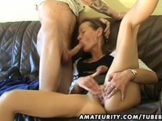 Amateur Milf toys her pussy, sucks and fucks with cum
